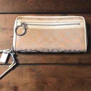Coach wallet w/wristlet strap. Lots of card slots.